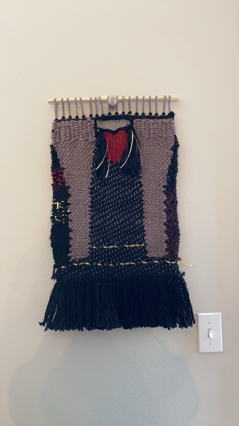 a weaving with fists of color raised